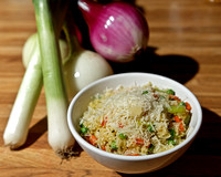Cous-cous with sliced leeks, carrots, peas and topped with freshly grated Parmigiano-Reggiano